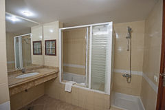 Bathroom with sink and shower Stock Photos