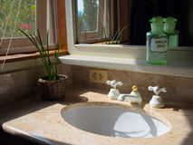 Bathroom sink. Sink stone bathroom in the rural property window - Brazil Stock Image