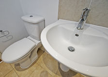 Bathroom sink and toilet Stock Photos