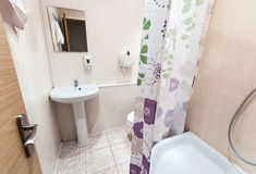 Bathroom with sink toilet and shower tray Stock Images