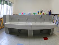 Bathroom with sinks for cleaning inside the nursery stock image