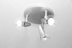 Bathroom Spotlight. Ceiling mounted spotlight in UK bathroom royalty free stock image