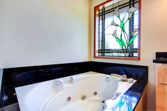 Bathroom with stained glass window Royalty Free Stock Image