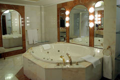 Bathroom suite. Modern and spacious bathroom suite designed with luxury Royalty Free Stock Photography