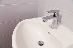 Bathroom tab. A modern basin mixer tap in a contemporary bathroom stock images