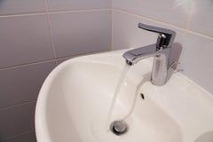 Bathroom tab. A modern basin mixer tap in a contemporary bathroom stock photo