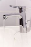 Bathroom tab. A modern basin mixer tap in a contemporary bathroom royalty free stock images