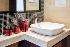 Bathroom tap. A modern style bathroom sink and fixture Royalty Free Stock Photography