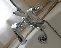 Bathroom Taps. This photo shows some bathroom taps in a 300+ year old house stock photo