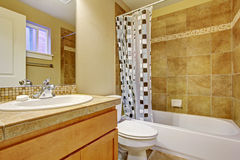 Bathroom with tile wall trim Stock Photography