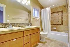 Bathroom with tile wall trim Stock Photos