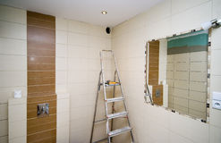 Bathroom tiles renovation. A bathroom being renovated, new tiles and raw walls, under construction. The bathroom is almost ready Royalty Free Stock Photos