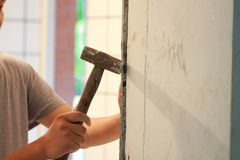 Bathroom tiles renovation. A man working at new bathroom tiles, putting them on the wall. HOME BUILDING & RENOVATION Royalty Free Stock Photo