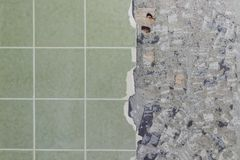 Bathroom tiles wall besides cracked and destroyed undersurface. To renovate Royalty Free Stock Image