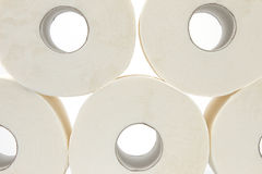 Bathroom tissue. Five rolls of bathroom tissue with a white background Stock Photo