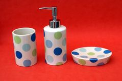 Bathroom toiletries. Set of bathroom toiletry. Bathroom toiletry of a liquid soap bottle, cup, and a dish of crockery Stock Photo