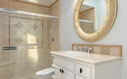 Bathroom with tub shower and glass doors stock photography
