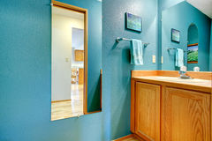 Bathroom turquoise wall with mirror Royalty Free Stock Photography
