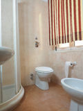 Bathroom two star hotel Milan Italy with bidet Stock Photo