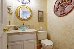 Bathroom vanity cabinet with glass vessel sink Stock Image