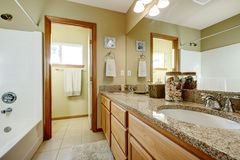Bathroom vanity cabinet with granite top and mirror Stock Images