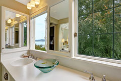Bathroom vanity cabinet with windows and bay view Royalty Free Stock Photos