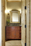 Bathroom with Vanity and Mirror. Bathroom sink and vanity seen through door Stock Photo