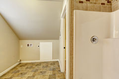 Bathroom with vaulted ceiling. Empty laundry area Stock Photography