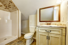 Bathroom with vaulted ceiling. Vanity cabinet and mirror Stock Photo