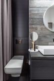 Bathroom with wall mounted toilet Stock Images