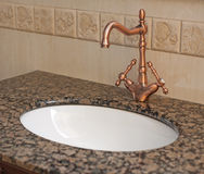 Bathroom washbasin and tap Stock Images