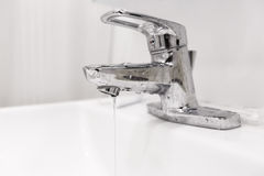 Bathroom water faucet with water leak Royalty Free Stock Photo