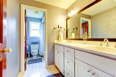 Bathroom with white cabinet and toilet area. Royalty Free Stock Images