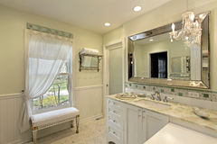 Bathroom with white cabinetry Royalty Free Stock Photo