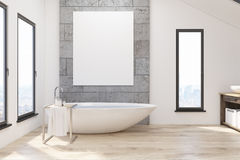 Bathroom with white tub and poster Royalty Free Stock Photos