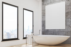 Bathroom with white tub and poster Stock Photography