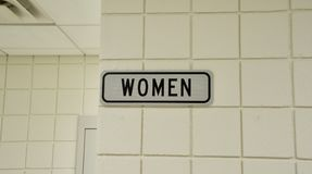 Bathroom for Women. A restroom sign indicates that this is a bathroom for women stock photos