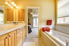 Bathroom with wood cabinets and tub. Stock Images