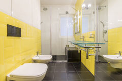Bathroom with yellow tiles. Modernly designed bathroom interior with yellow tiles Royalty Free Stock Photography