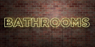 BATHROOMS - fluorescent Neon tube Sign on brickwork - Front view - 3D rendered royalty free stock picture Royalty Free Stock Photo