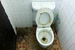 Bathrooms and dirty old toilets bowl. Bathrooms is not very clean and dirty old toilets bowl royalty free stock photo