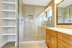 Bathroon interior with vanity cabinet, two sinks and opened glass shower door. Northwest, USA royalty free stock photos