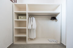 Bathrope, safe box and cloth hanger in wardrope Stock Images