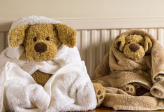 Bathtime for the boys. Cuddly toys drying after a bath Stock Photo