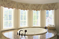 Bathtub. View of elegant bathtub with bright window lighting Stock Image