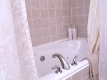 Bathtub. In the bathroom, bathtub with jets Stock Image