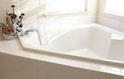 Bathtub. White home bathtub in the sunny morning Royalty Free Stock Photo