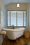 Bathtub. Luxury white vintage bathtub with basket and towels Stock Photography