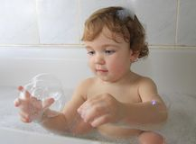 In a bathtub royalty free stock image