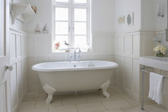 Bathtub In Bathroom. Freestanding bathtub in bathroom Royalty Free Stock Photography